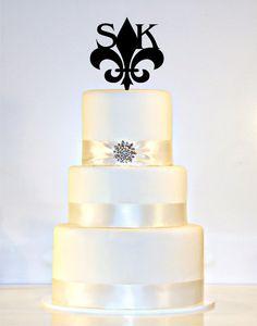 Hey, I found this really awesome Etsy listing at http://www.etsy.com/listing/168811935/fleur-de-lis-monogram-wedding-cake
