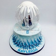 Frozen birthday cake, snow globe cake, Frozen party ideas.
