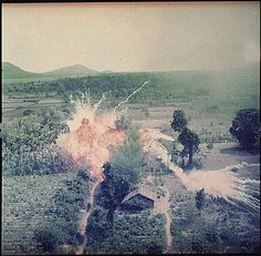 NAPALM EXPLODING ON VIET CONG STRUCTURES