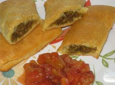 Ground beef wrapped in crescents gets all spiced up, Jamaican style.  Found this on the Pillsbury site recipe by Diane Joyce Phillips from Va. in the 2002 bake-off. We have them a lot down here and I like this crust better - no lard ! This is my first recipe I am at your mercy !