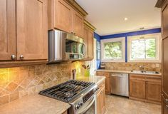 10249 RR 1, Uxbridge - Kitchen, wood stove and cozy, casual dining ...