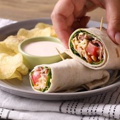 Spice up your wrap routine with this Buffalo Chicken Wrap that's coated in spicy sauce and loaded with bacon. Spice up your wrap routine with this Buffalo Chicken Wrap that's coated in spicy sauce and loaded with bacon. Buffalo Chicken Wraps, Healthy Buffalo Chicken Dip, Lunch Recipes, Cooking Recipes, Healthy Recipes, Amish Recipes, Game Recipes, Chicken Wrap Recipes, Spicy Chicken Wrap