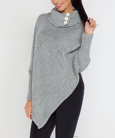 Fobya Gray Wool-Blend Poncho | zulily  . $34.99 $89.00 size: size chart One Size Product Description:  Stay snug in this cozy wool-blend poncho, featuring long sleeves for extra warmth and a button accent at the neckline for a polished touch.  Size note: This item is from a European brand. Please refer to the size chart to ensure best fit.      Fits S-L     33.4'' long from high point of shoulder to hem     Knit     80% wool / 20% acrylic     Hand wash; hang dry     Imported