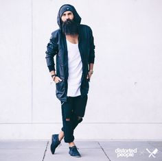 Distorted People Streetstyle : Blades Black Parka, Blades Grey Beanie, combined with a white tanktop, black denim jeans and black chukka boots