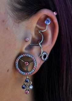 Piercings, ear tunnel with crystals, super industrial #piercings #bodyjewelry