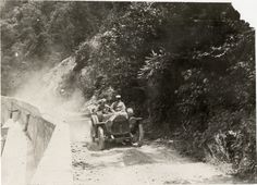 Motorists in Marmon automobile traveling on mountain road at Delaware Water Gap, 1908 Glidden Tour