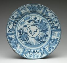 VOC plate - Dutch East Indies company Plate with monogram of the Dutch East India Company, Edo period (1615–1868), ca. 1660 Japan Porcelain with underglaze blue (Arita ware); H. 2 3/8 in. (6 cm), Diam. 12 3/8 in. (31.4 cm), Diam. of foot 6 3/8 in. (16.2 cm) Dr. and Mrs. Roger G. Gerry Collection, Bequest of Dr. and Mrs. Roger G. Gerry, 2000 (2002.447.40)