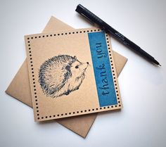 This square greetings card features my original hedgehog illustration with 'thank you' on a blue band of colour, and is blank inside for your own message. A lovely way to say thank you to a hedgehog lover.  Please check out my other listings in the Cards section of my shop for alternative animals! www.etsy.com/uk/shop/BitterLimeDesigns?ref=hdr_shop_menu§ion_id=18496408 ❂ MATERIALS The card has been laser printed on lovely quality 280gsm recycled brown Kraft card. Plea...