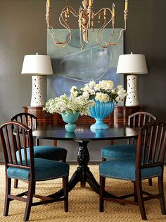 Rich Color Scheme..Beautiful  sophisticated statement by combining three saturated hues. Here, a background of darkly stained wood furniture is the catalyst that propels cerulean blue chair covers to focal-point status...Cerulean + Slate + Mahogany