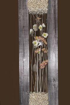 Formschön eingerahmter Raumschmuck aus trockenen Floralien