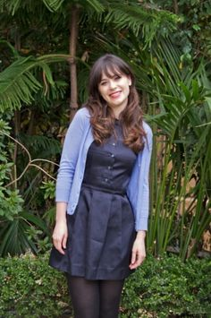 Zooey Deschanel's Navy button front dress and blue cardigan at New Girl press conference.