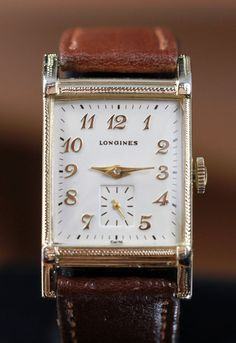I covet this 1948 Longines watch. I know that's a sin, but deal with it.