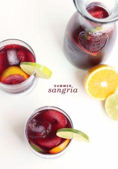 Summer Sangria | 1 bottle of dry red wine, 1 c. freshly squeezed orange juice, 1/3 c. sugar, 1/3 c. tequila, 1 orange, sliced, 1/2 lb. (8 oz.) strawberries, sliced, 1 lime, sliced, sparkling water.