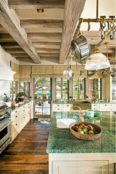 Having the overhead pots and pan's hanger. Just the rustic feel of the kitchen. I would love this in my house