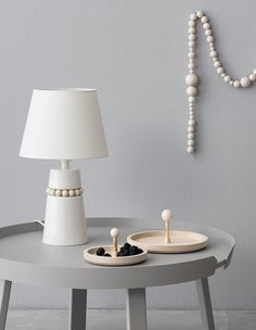 Aarikka represents unique Nordic design since The company makes wood jewellery and home products out of natural materials. Handmade Lamps, Table Top Lamps, Lamp, Lamp Design, Light Fittings, Rustic Lighting, Ceiling Lamp, Basket Lighting, Diy Home Accessories
