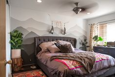 mountain wall mural paint bedroom decor Rustic & Cozy Cabin Vibes in Los Angeles bedroom with mountain mural- modern boho
