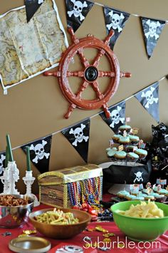 30 incredible pirate party ideas - amazing! We love this table setup for snacks + desserts.