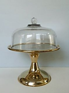 Hey, I found this really awesome Etsy listing at https://www.etsy.com/listing/191331588/vintage-gold-cake-stand-glass-cake-dome