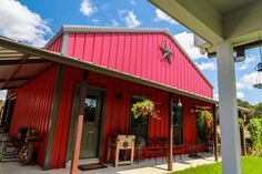 Rustic Red Siding And Burnished Slate Colored Roof Barn