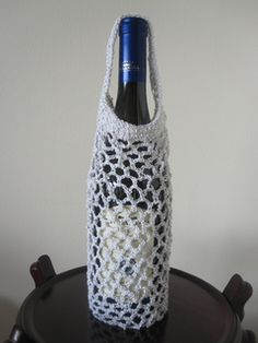 This is a variation on the first wine tote pattern I posted earlier. This has different handles.