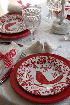 Light and airy country-style table setting done in red and white.