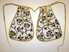 A pair of 18th-century pockets.  These were removable pockets that a lady would wear tied around her waist, accessed through slits in her skirts and petticoats.
