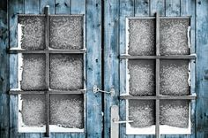 Closed for Winter Old frosty doors and windows. Selectively colored black and white photograph. Finland 2011. Ari Salmela