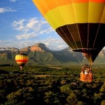 Hot-Air Ballooning - Sun Catchers Hot-Air Ballooning. Experience the magic of lighter-than-air flight. Every good-weather morning at sunrise, our balloons depart from our launch site near Hoedspruit. Come aboard for the experience of a lifetime. We offer one-hour long flights over the scenic lowveld section of the Blyde River, west of Hoedspruit.