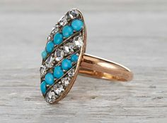 Vintage Victorian ring made in 18k rose gold featuring alternating rows of cabochon turquoise and rose cut diamonds. Circa 1890.