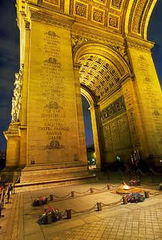 A view under the arches of arc de Triomphe at night