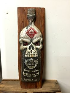 Hand carved skull bottle fire station art