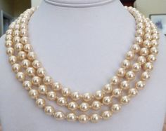 """This is a beautiful 3-strand FRANKLIN MINT Jackie Kennedy inspired """"Jackie's Pearls"""" European hand knotted glass faux creamy pearl necklace with an antiqued Art Deco style silvertone rhinestone ornate clasp.  One pearl shows wear, a few pearls have slightly dulled, most are luminous, the rhinestones sparkle, there is no silver plate wear, the clasp works well.  The shortest strand is 18 3/4 inches, the longest is 21 1/2 inches with a 2 inches width drape, it weighs a substantial 125.2 grams…"""