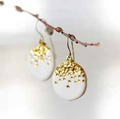 Round porcelain pendant earrings with carved and highlighted 22k gold detailing. These sweet earrings dangle from fine, 14k rolled gold french-hook wires. Inspired by celebration fireworks when the clock strikes midnight to ring in the New Year! A touch of elegance with minimal styling effort.