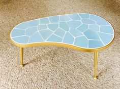 Perfect addition to complete your mid century look. Stunning Mosaic kidney shaped tripod table imported from Germany in a beautiful light blue and gold color. This is a rare find! Excellent conditions! Traditionally these small tables were used to display plants or other small objects. The legs screw off for easier and affordable shipping. This is an original vintage item from 1950s - 1960s, not a reproduction.   Conditions: The table is in excellent condition for its age. No watermarks…
