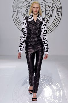 FALL 2013 READY-TO-WEAR  Versace /   Versace went punk this season – or 'vunk' as Donatella called it – to a stellar front row that included Janet Jackson, Lana del Ray, Christopher Kane and her new prodigy J.W. Anderson. The clothes screamed sex, with a capital 'S'. Studs, buckles and chains worked their way around black PVC trousers, kilts, bondage jackets and bodycon dresses that came artfully slashed – punk style – across the chest.Viva La Vunk.