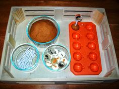 Fine motor activity: roll playdough into balls and place into ice tray, stick in a golf tee and balance a ball or marble on top.