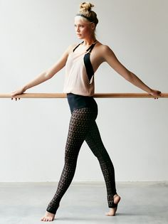 Lace Stirrup Tight | Sheer stretch lace tights with a geo pattern and heel cutouts. Style over one of our Signature Seamless styles to complete the look. Wide elastic waistband.