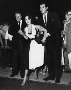 Elizabeth Taylor and Rock Hudson cement their claim to lasting fame in Hollywood's traditional way, leaving their imprints in wet cement at the Chinese Theatre - 26 September 1956