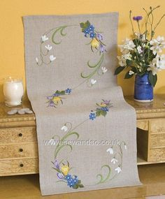 [ Spring flowers table runner, embroidery Modern blue embroidery entwines a geometric lattice on our Simple Embroidery Designs, Machine Embroidery Designs, Embroidery Stitches, Embroidery Patterns, Hand Embroidery, Flower Embroidery, Machine Design, Satin Stitch, Cross Stitch Flowers