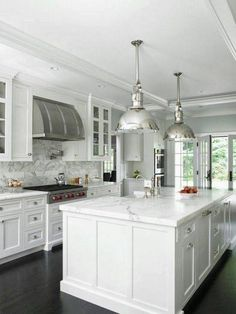 All white kitchen. Love the hood! Beautiful