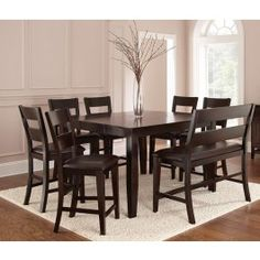 """The Victoria Collection is crafted from hardwood solids with a Dark Espresso finish. This 9 piece set includes the Victoria counter table, with an 18"""" butterfly leaf, and 8 counter chairs with upholstered seats in Dark Brown vinyl. *Counter Bench NOT included* Table Size: 36H x 54D x 36-54W"""
