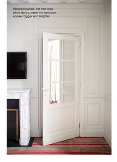Mirrored panels, set into crisp white doors, make the bedroom appear bigger and brighter   domino.com