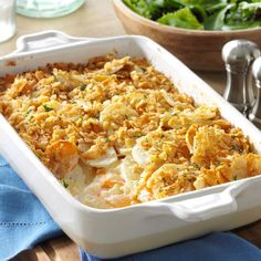Dijon Scalloped Potatoes Recipe -My family loves this creamy and colorful recipe for cheesy potatoes. It has both sweet and white potatoes, lots of rich, buttery flavor and a pretty, golden-crumb topping. —Carolyn Putnam, Norwalk, Ohio