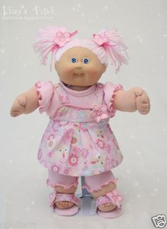 Pixie Dust Scented Custom Cabbage Patch Reroot with Pink and White Double Pom-Poms, a stretch knit t-shirt and leggins with lettuce edging, and cute sparkly romper, and matching sandals.