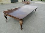 """£2900 Art Nouveau influenced Victorian mahogany extending wind out dining table with solid top, delicately carved at the moulding and opening to incorporate any combination of the three original extension leaves to provide seating for 6 to 12 people comfortably. Standing on cabriole peg foot legs any currently in mature finish Can be polished by our in house team to your specification -e. Measures 118"""" long x 54"""" wide fully exten..."""