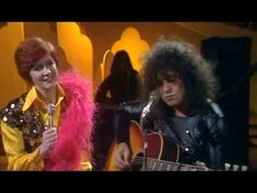 """""""BBC: Kings of Glam"""" - Profiling the leading men of the glam rock era, Lisa Tarbuck guides us through the glittering careers of Marc Bolan, David Bowie, Noddy Holder, Brian Ferry, Elton John and honorary glam king Suzi Quatro. Industry men including producer Tony Visconti, songwriter Mike Chapman and photographer Mick Rock give the insider angle to the work of these artists."""