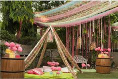 innovative mehndi decor ideas | Kitschy and creative pink and lime green neon mehendi decor with camp style canopy with gaddi and floor cushions of rtes bridal seat | The ultimate guide for the Indian Bride to plan her dream wedding. Witty Vows shares things no one tells brides, covers real weddings, ideas, inspirations, design trends and the right vendors, candid photographers etc.| #bridsmaids #inspiration #IndianWedding | Curated by #WittyVows - Things no one tells Brides…