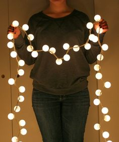 Make faux globe lights with Christmas lights and ping pong balls!