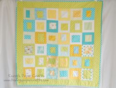 quilt card inspiration quilt ... white with yellow and turquoise ... squares withing squares in a grid ...