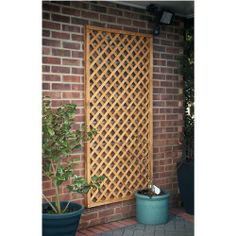 lattice garden fence ideas - Google Search Great way to dress up a boring brick exterior wall.